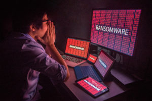 ransomware attack on desktop screen, notebook and smartphone, cyber attack and internet security concepts
